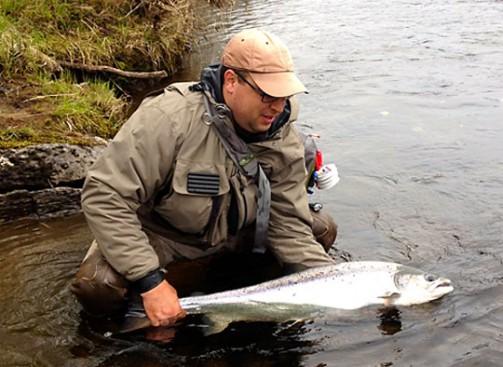 Ben Bilello with a salmon he caught