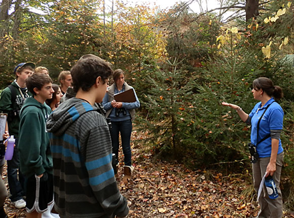 A teacher-naturalist leads a program on the trails of the Connecticut Audubon Society's Fairfield site. More people interested in sharing their knowledge and love of nature are needed.