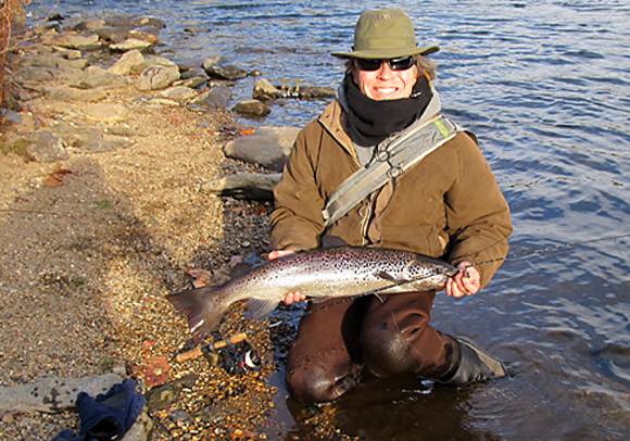 Ron Merly holds a 32-inch salmon caught below the Tingue Dam recently.
